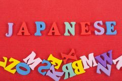 JAPANESE word on red background composed from colorful abc alphabet block wooden letters, copy space for ad text. Learning english concept stock photo