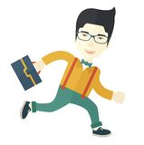 Japanese Worker with briefcase is running Stock Images