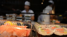 Japanese workers prepare Sushi rolls stock footage