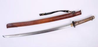 Japanese WW11 Shin Gunto NCO Katana. Sword. Japanese WW11 NCO Shin Gunto Katana sword with leather field cover Stock Photography