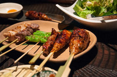 Japanese yakitori in Japan. A mixed plate of Japanese yakitori grilled chicken plus a salad in a Tokyo restaurant Royalty Free Stock Images