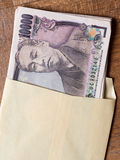 Japanese 10000 yen bill in the envelope Royalty Free Stock Photography