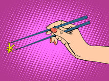 The Japanese yen and chopsticks. Pop art retro style. Financial concept the Japanese economy and successful businesswoman Royalty Free Stock Images
