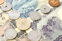 Japanese Yen currency. Japanese coins 500 yen in focus. The photo for  business concept  price promotion or money activity Royalty Free Stock Images