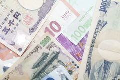 Japanese Yen and Euro notes Royalty Free Stock Image