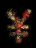 Japanese yen fireworks. Japanese yen symbol made of fireworks on black background Royalty Free Stock Photo