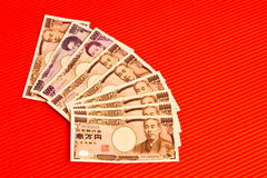 Japanese yen notes on red. Japanese yen currency notes on red background Royalty Free Stock Images