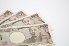 Japanese yen notes stretched out on white background.selective focus. Royalty Free Stock Photo