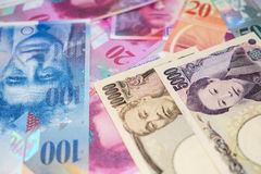 Japanese yen and Swiss franc. Royalty Free Stock Image