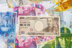 Japanese yen and Swiss franc. Stock Photo