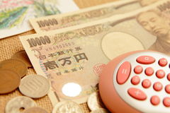 Japanese yen (ten thousand money ) with calculator Stock Photography