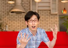 Japanese young man having a flash of good idea Royalty Free Stock Photography