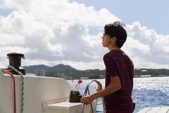 Japanese young man sailing yacht stock photo
