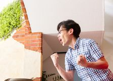 Japanese young man, watching sport game, yelling and shouting encouragement Stock Images