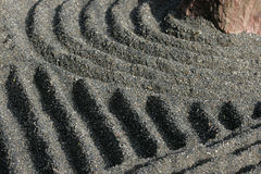 Japanese Zen Garden. Some detail of a Zen garden in Kyoto. The gravel has been raked by monks. These gardens typically contain sand or gravel and bare stones royalty free stock photography
