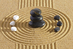 Japanese ZEN garden with Feng shui. In sand with stones of yin yang stock photo