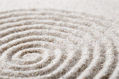 Japanese zen garden meditation for concentration and relaxation sand for harmony and balance in pure simplicity. Macro lens shot Royalty Free Stock Image