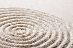 Japanese zen garden meditation for concentration and relaxation sand for harmony and balance in pure simplicity. Macro lens shot Stock Image