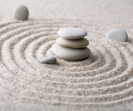 Japanese zen garden meditation stone for concentration and relaxation sand and rock for harmony and balance in pure simplicity Stock Photos