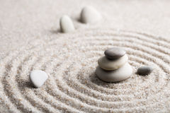 Japanese zen garden meditation stone for concentration and relaxation sand and rock for harmony and balance in pure simplicity. Macro lens shot Royalty Free Stock Image