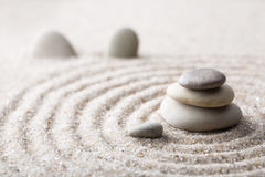 Japanese zen garden meditation stone for concentration and relaxation sand and rock for harmony and balance in pure simplicity. Macro lens shot Royalty Free Stock Photography