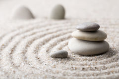 Japanese zen garden meditation stone for concentration and relaxation sand and rock for harmony and balance in pure simplicity Royalty Free Stock Images