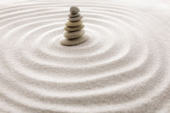 Japanese zen garden meditation stone for concentration and relaxation sand and rock for harmony and balance in pure simplicity Royalty Free Stock Image
