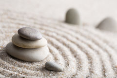 Japanese zen garden meditation stone for concentration and relaxation sand and rock for harmony and balance in pure simplicity - m Royalty Free Stock Photos