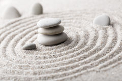 Japanese zen garden meditation stone for concentration and relaxation sand and rock for harmony and balance in pure simplicity - m stock image