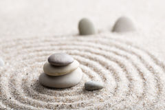 Japanese zen garden meditation stone for concentration and relaxation sand and rock for harmony and balance in pure simplicity - m stock images
