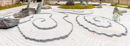 Japanese zen garden meditation stone in lines sand Stock Photography