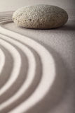 Japanese zen garden raked sand stone meditation. Zen garden japanese garden zen stone with raked sand and round stone tranquility and balance ripples sand Stock Images