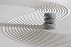 Japanese ZEN garden. With stacked stones in raked sand Stock Images