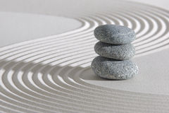 Japanese zen garden. With stacked stones in white sand Stock Photography