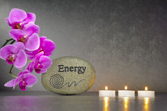 Japanese ZEN garden with stone of energy. And candle lights in row with orchid flower Stock Photos