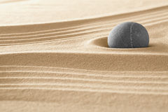 Japanese zen garden. Stone and sand pattern for relaxation and meditation stands for harmony and spirituality or relaxation spa wellness background Royalty Free Stock Image