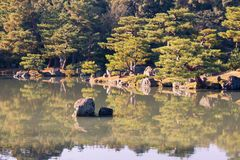 Japanese zen garden with water lake. And reflection Royalty Free Stock Photo