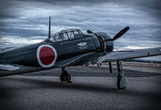 Japanese Zero. Redding, California, USA- September 28, 2014: A Japanese Zero belonging to the Commemorative Air Force sits on the runway at dawn during the stock photo