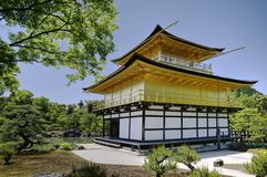 Kinkaku-ji, Golden Pavillion temple, Kyoto, Japan. Japanesse buddhist temple Kinkaku-ji - Golden Pavillion - with pines and pond from back side in Kyoto Royalty Free Stock Images