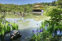 Kinkaku-ji, Golden Pavillion temple, Kyoto, Japan. Japanesse garden with pond, island with pines, flowers and stone, and buddhist temple Kinkaku-ji - Golden Stock Photo