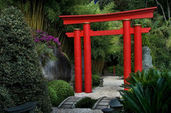 Japanesse Gate. A beautiful red japanesse gate in a garden Stock Photo