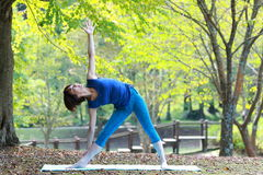 Japanewe woman doing yoga triangle pose Stock Photography
