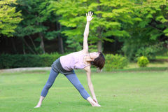 Japanewe woman doing yoga triangle pose Royalty Free Stock Photography