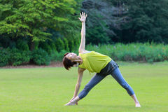 Japanewe woman doing yoga triangle pose Royalty Free Stock Photo