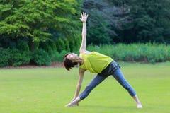 Japanewe woman doing yoga triangle pose Royalty Free Stock Photo