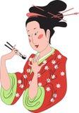Japanische Dame, die Sushi isst Stockfotos