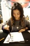 Japanische Frau an BIT 2012    Lizenzfreie Stockfotos