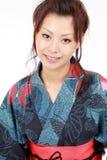 Japanische Frau mit Kleidungs-Kimono Stockbild