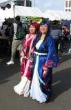 Japanische Frauen-tragende Kimonos Stockbilder
