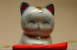 Japanische glückliche Katze Stockfotografie